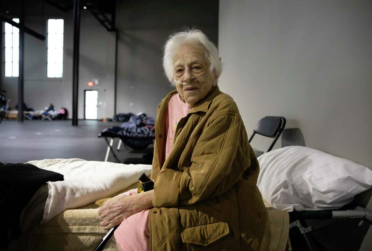 Maria D'Angelo, 87, poses for a portrait inside the Church Project, Thursday, Feb. 18, 2021, in The Woodlands. D'Angelo lives off oxygen 24/7 and was forced to travel from south west Houston to Spring around 2 in the morning on Wednesday, Feb. 16, due to swarming power outages in the State due to the arctic storm.