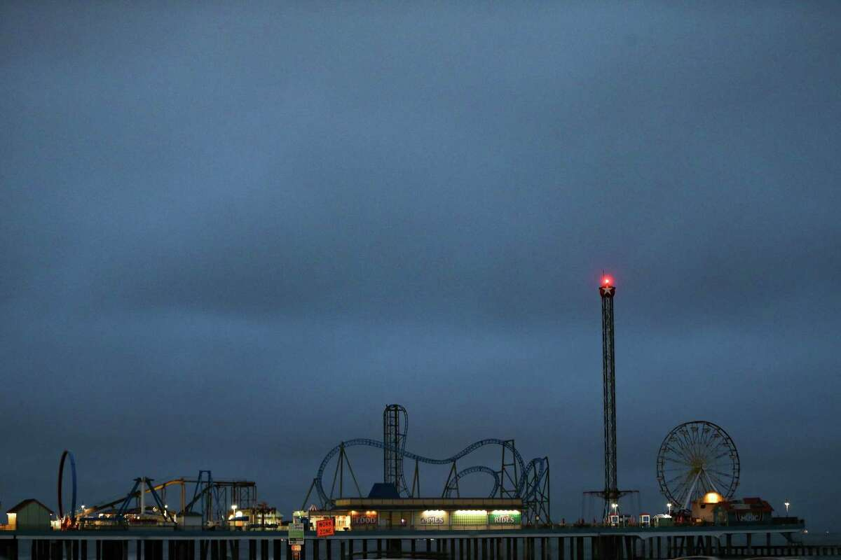 Carnival ride lights remain off on Galveston Pier as much of the island struggles with power outages on Wednesday, Feb. 17, 2021.