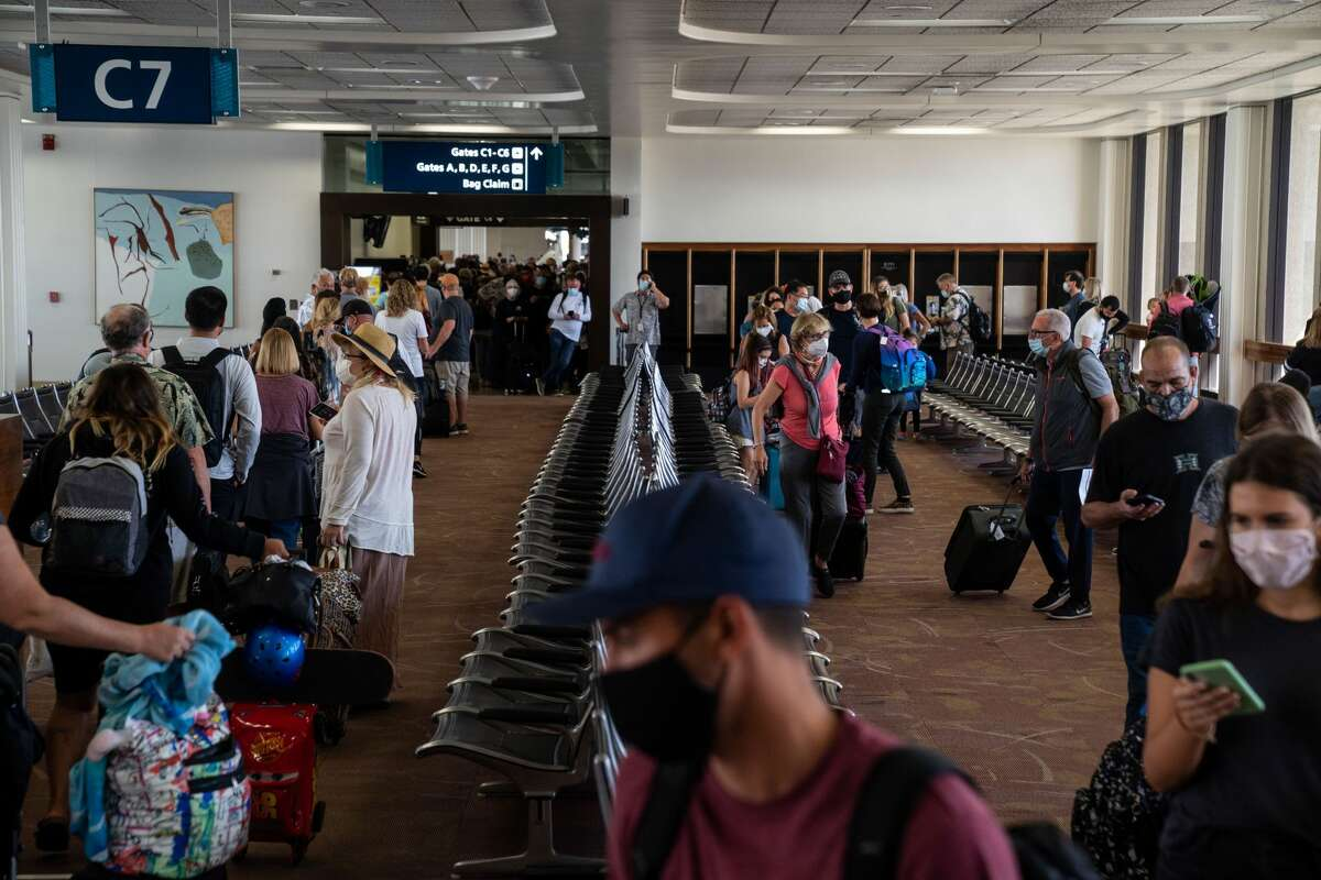 Many arriving passengers faced long waits as state officials checked to be sure all arrivals had answered a health questionnaire, had their temperatures taken and shown proof of a negative COVID test, at Daniel K. Inouye International Airport.