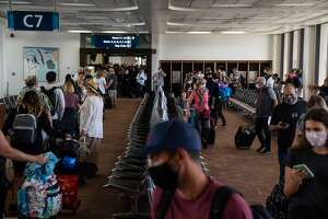Many arriving passengers faced long waits as state officials checked to be sure all arrivals had answered a health questionnaire, had their temperatures taken and shown proof of a negative COVID test, at Honolulu International Airport.