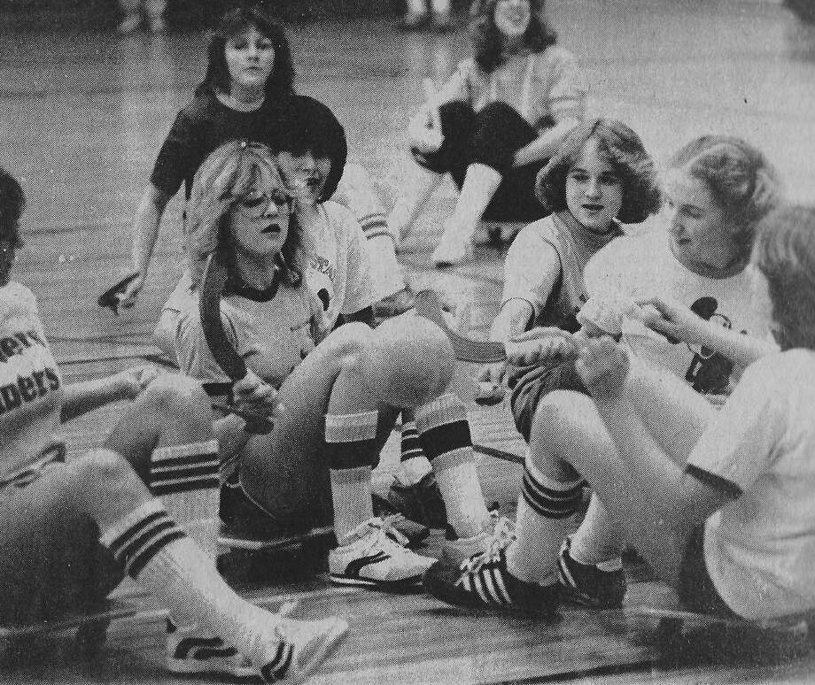 It was Winter Carnival Week at Manistee High School on this day in 1981 and despite having puddles where snowbanks once stood, the students were still celebrating February with class competition that was going on all week long. Pictured here are freshmen and sophomores battling in a game of scooter hockey in the gym. (Manistee County Historical Museum photo)