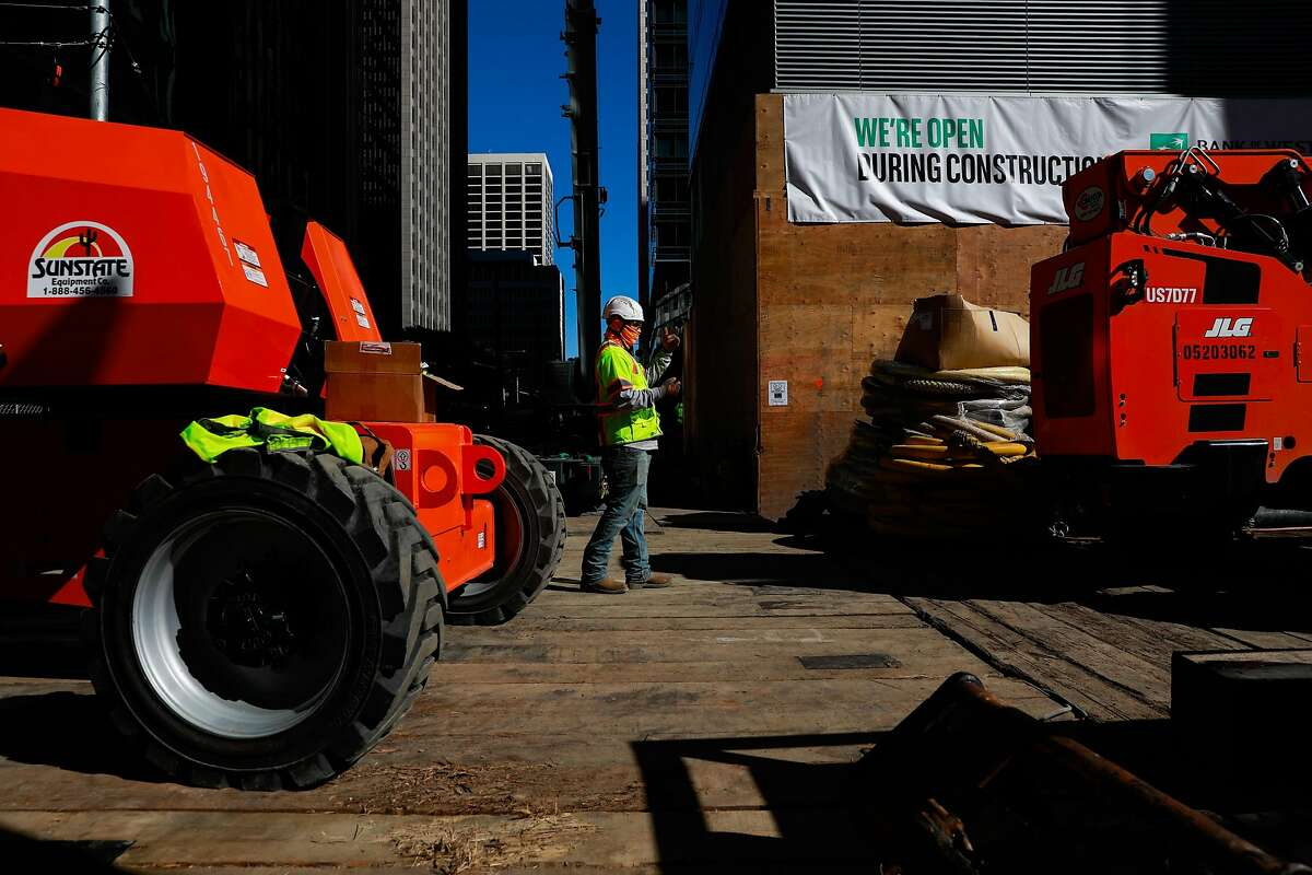 Laborers work to fix the foundation of Millennium Tower on Mission Street.