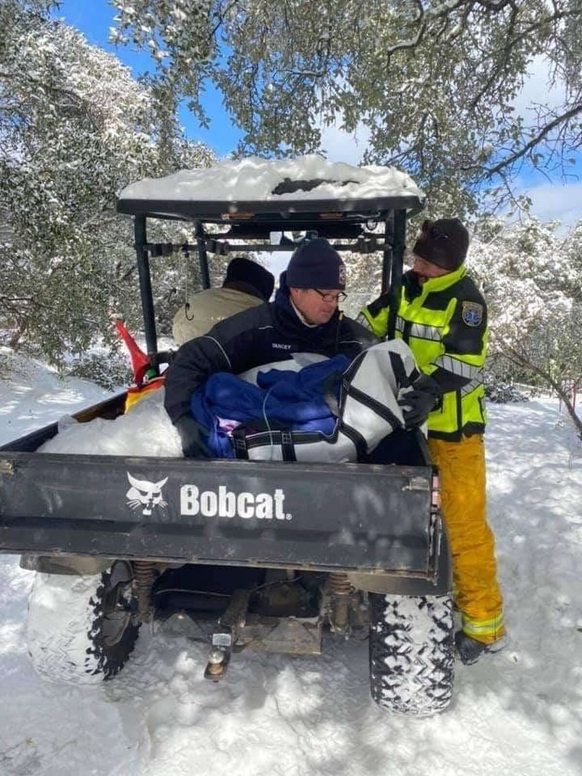 With an ambulance stuck in the snow, Austin paramedics had to resort to warming a 98-year-old patient in a utility vehicle.