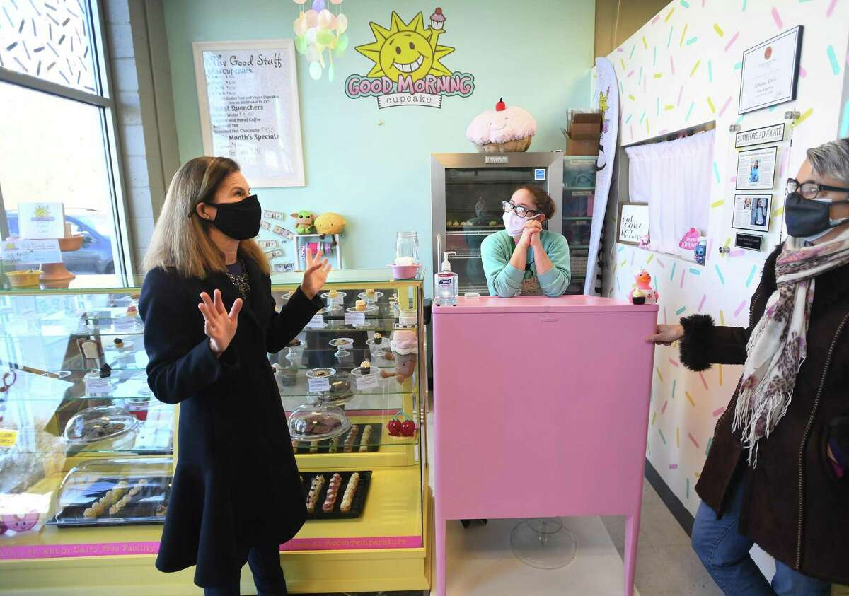 From left: Lt. Gov. Susan Bysiewicz chats with business owner Adrianna Robles and Women's Business Development Council President and CEO Fran Pastore at Robles' Good Morning Cupcake on Melba Street in Milford on Feb. 4. Robles received a business grant as part of the group's Equity Match Grant program.