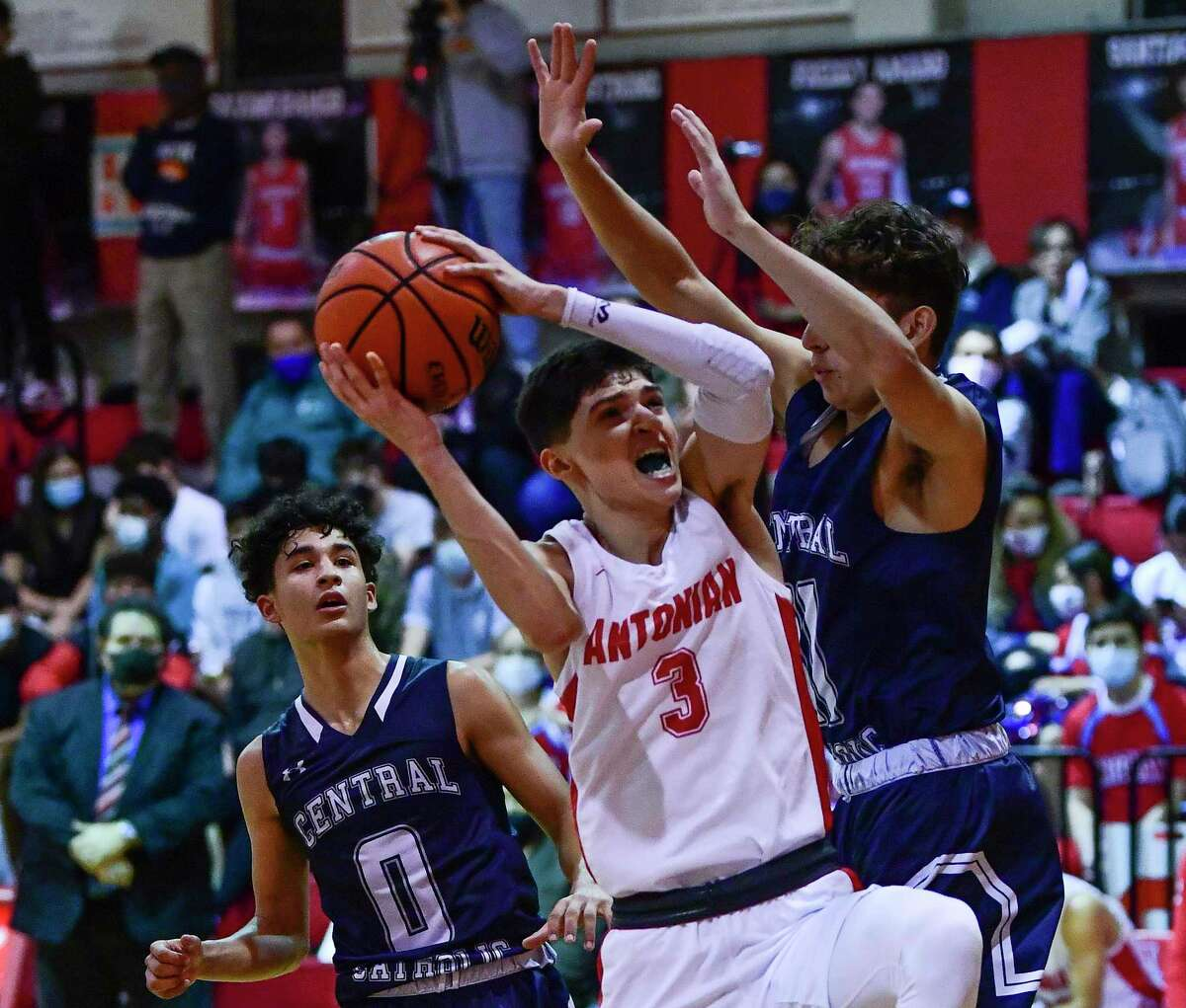 Antonian's Gavino Ramos scores against the Central Catholic defense during high school basketball action on Friday night, Feb. 5, 2021.