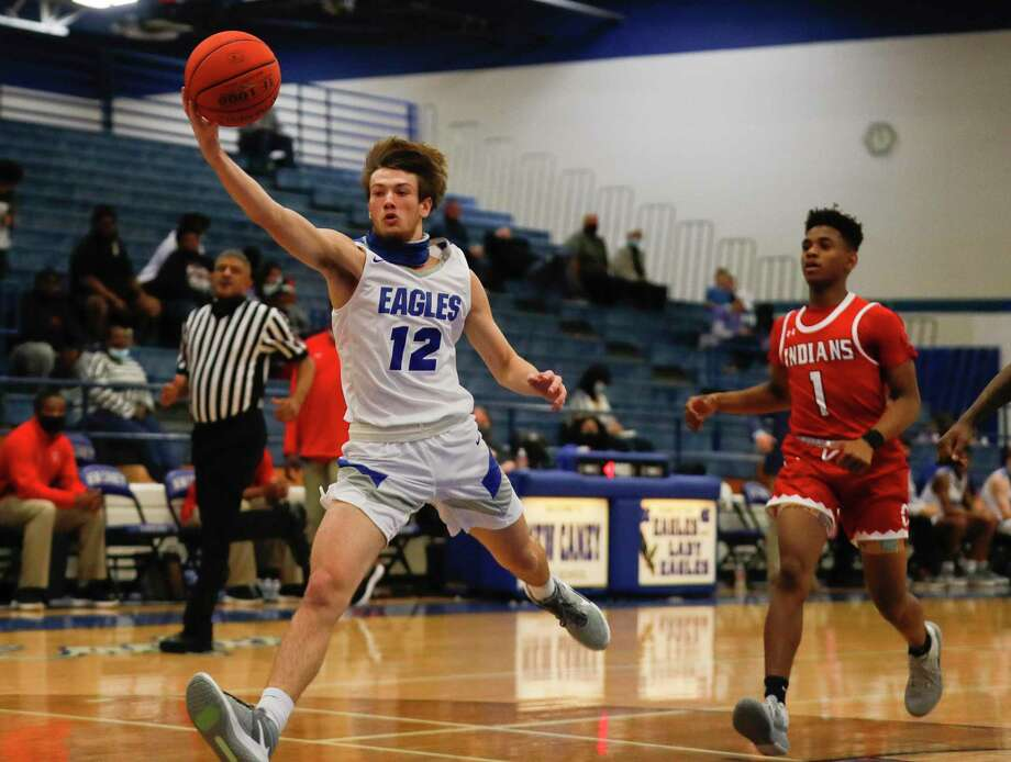 New Caney small forward Samuel Brandon (12) and the Eagles will face Katy Paetow in the Region III-5A bi-district playoffs on Saturday. Photo: Jason Fochtman, Houston Chronicle / Staff Photographer / 2021 © Houston Chronicle