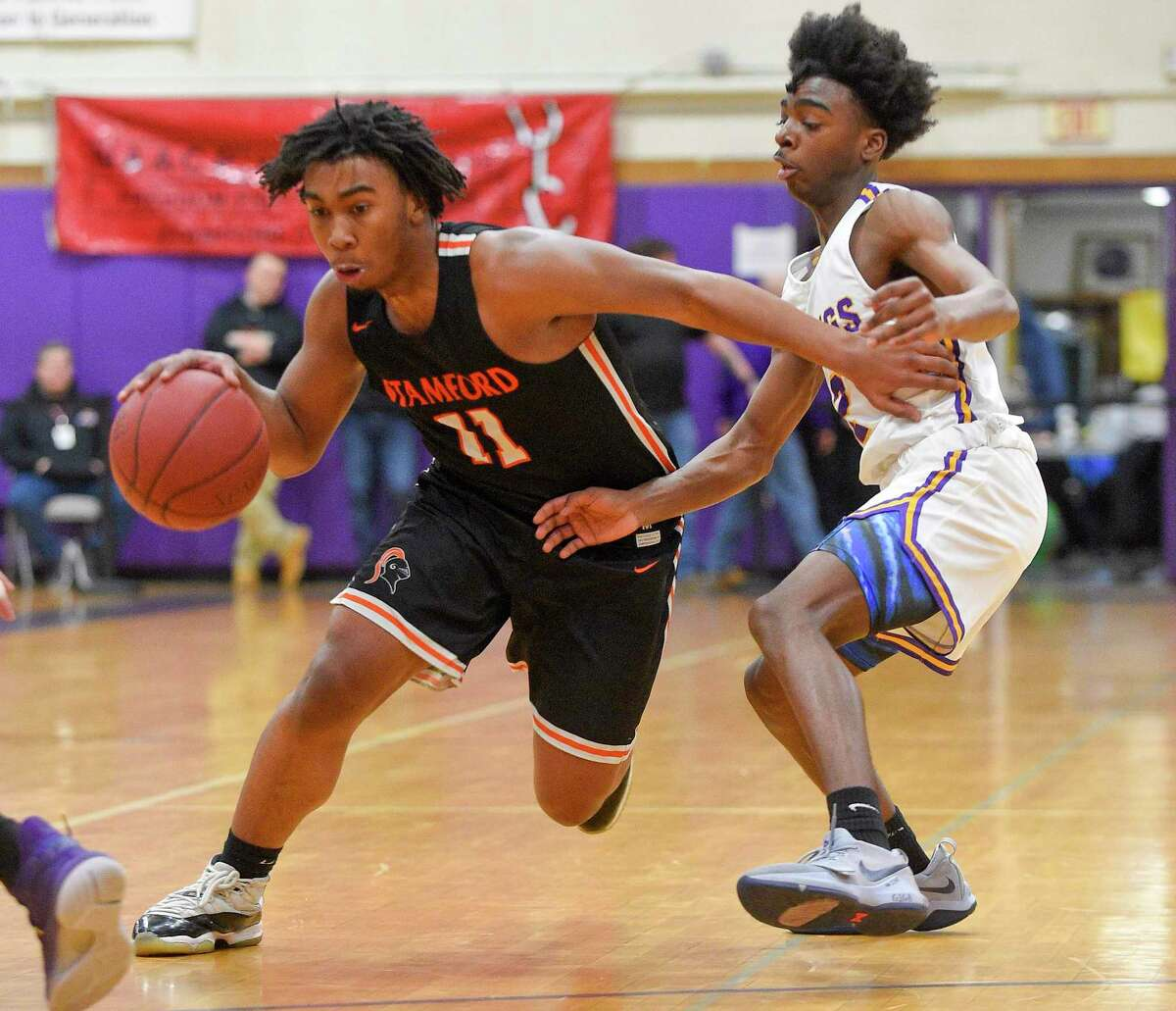 City rivals Stamford and Westhill in action during a boys basketball game in 2020 at Westhill High.