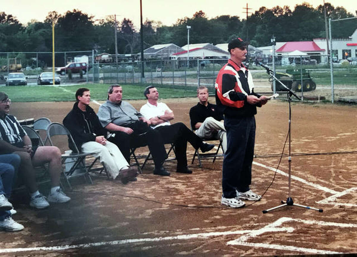 Former Edwardsville/Glen Carbon Little League Association commissioner Vince Allaria speaks during a dedication ceremony for the renovated Leclaire Field in 2000. Behind Allaria, left to right, are alderman Rich Rezabek, Park Board chairman Joe Gugger, Mayor Gary Niebur, Parks Director Bob Pfeiffer and EGCLLA board member Joe Hattrup.