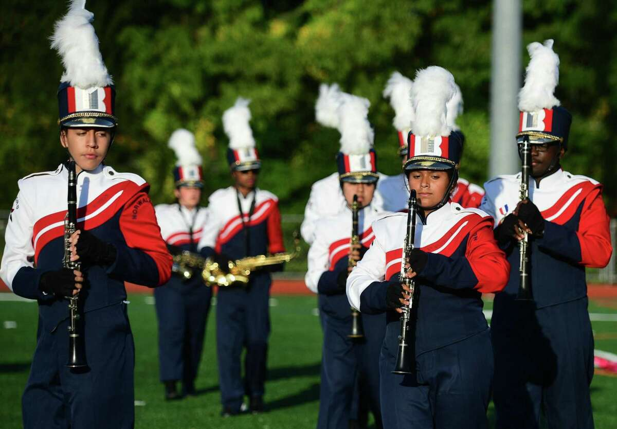 Brien McMahon High School Marching Band perform their halftime field show as Norwalk High School hosts The Cavalcade of Bands Saturday, October 12, 2019, at the school in Norwalk, Conn.