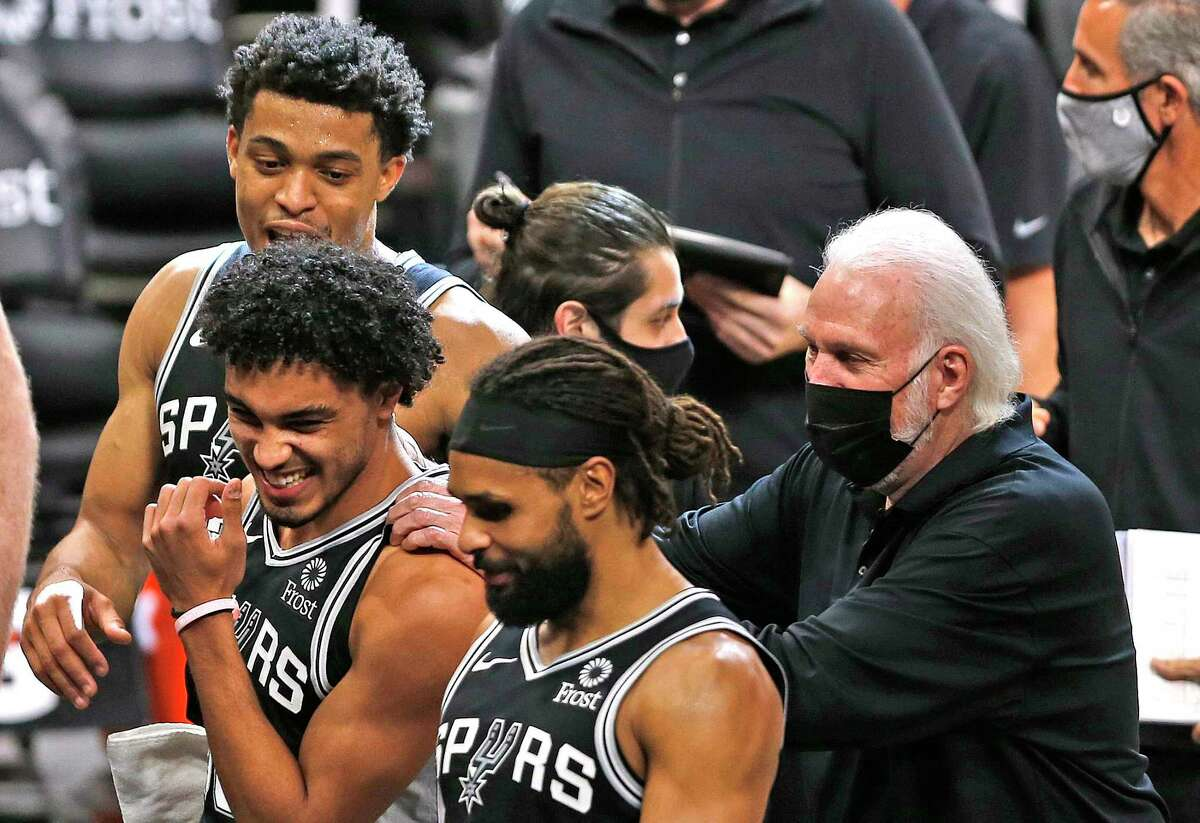 SAN ANTONIO, TX - JANUARY 29: Gregg Popovich head coach of the San Antonio Spurs jokes with Tre Jones #33 who was able to get in the game as Spurs defeated Denver Nuggets 119-109 at AT&T Center on January 29 , 2020 in San Antonio, Texas. NOTE TO USER: User expressly acknowledges and agrees that , by downloading and or using this photograph, User is consenting to the terms and conditions of the Getty Images License Agreement. (Photo by Ronald Cortes/Getty Images)