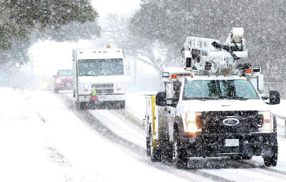 """CPS Energy crews were seen driving along Vance Jackson Road during another day of snow in San Antonio on Thursday, Feb 18, 2021. """"This extreme weather event has caused unimaginable hardships,"""" SAWS President and CEO Robert R. Puente says of the arctic blast that left hundreds of thousands without power for hours at a time while also leading to burst pipes and other water supply problems."""