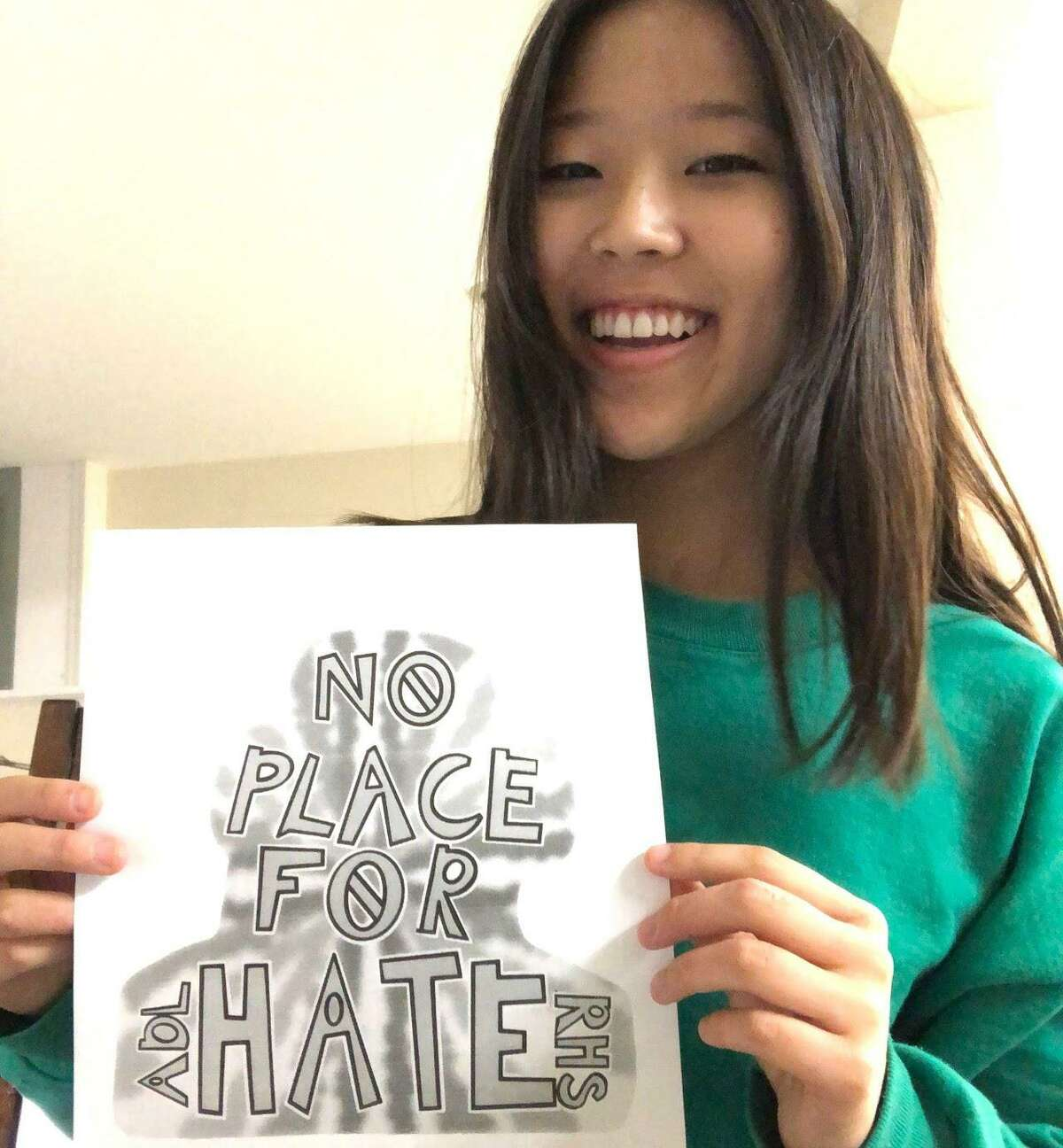 Lauren Kim with a No Place for Hate drawing