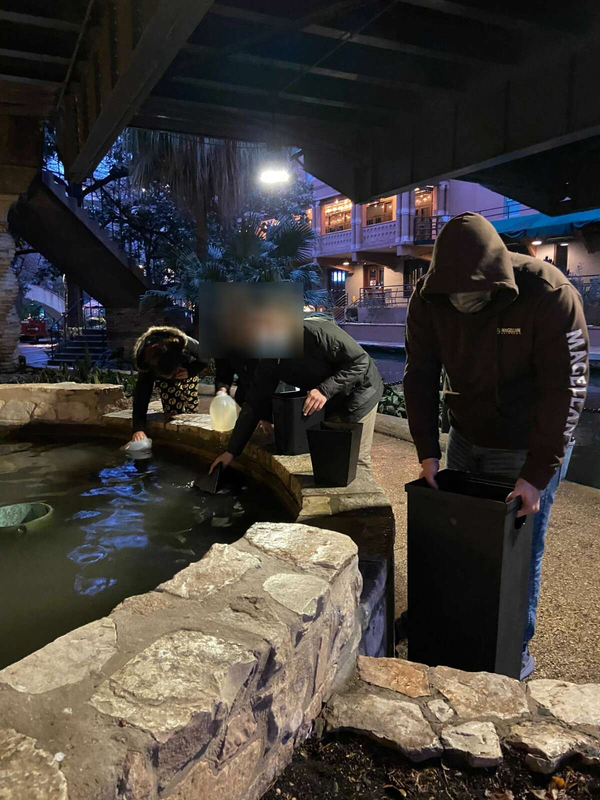Downtown guests resorted to collecting San Antonio River water amid the utility issues plaguing Texas in the wake of winter weather.