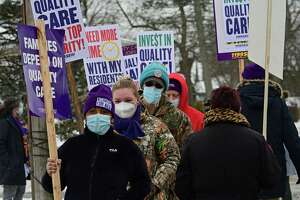1199SEIU nursing home workers hold a demonstrations at the entrance to the Schenectady Center for Rehabilitation and Nursing on Thursday, Feb. 18, 2021 in Schenectady, N.Y. Nursing home workers are holding demonstrations and vigils at more than 20 nursing homes across New York State, calling for greater transparency and investment in quality resident care. (Lori Van Buren/Times Union)