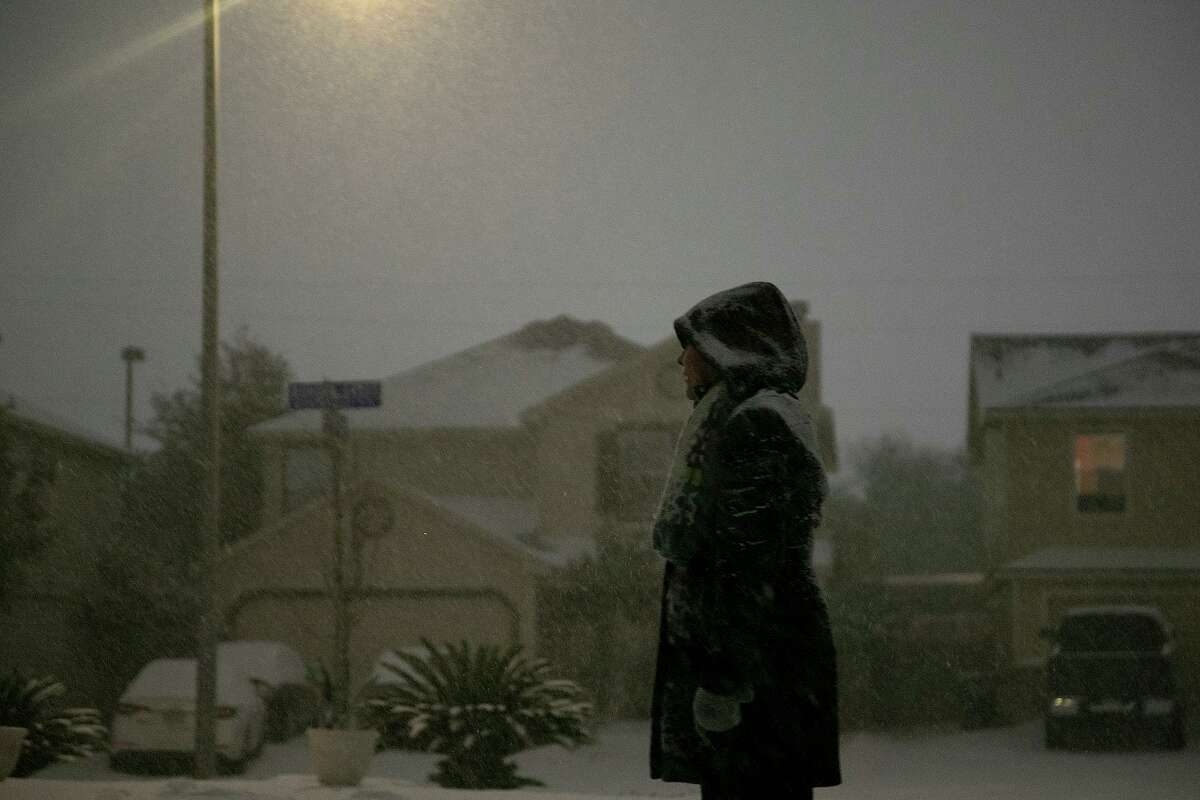 Georgina Rodriguez watches the snow fall late Sunday night, Feb. 14, 2021, in San Antonio. The storm likely will produce the largest number of insurance claims in the state's history, according to the Insurance Council of Texas.
