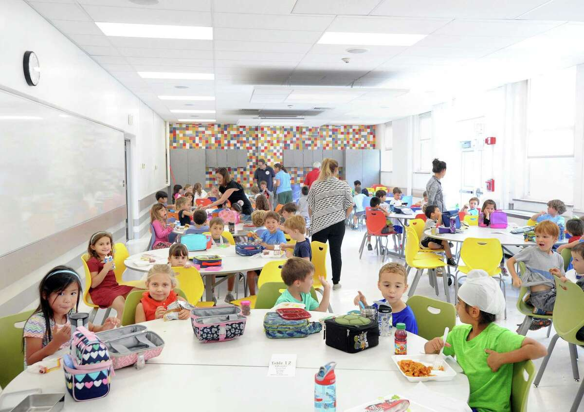 Kindergarten students eat lunch in the renovated cafeteria at the Riverside School in Greenwich, Conn., Friday, Sept. 22, 2017.