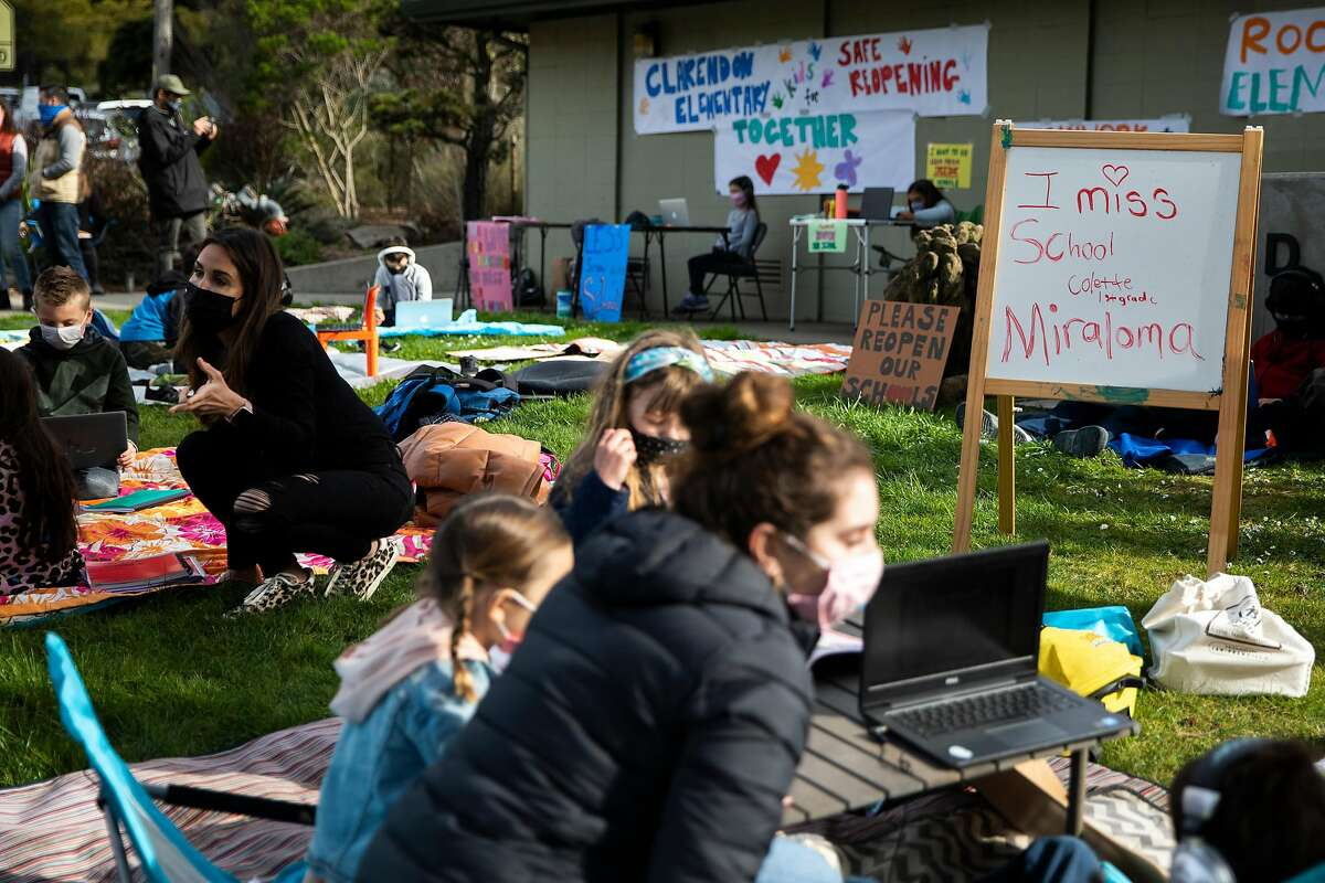Families gather at Midtown Terrace Park across the street from Clarendon Elementary School in San Francisco, Calif. Thursday, February 18, 2021 to participate in a