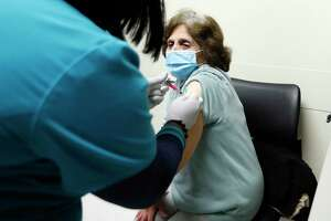 Endelia Juarez, 80, gets her first dose of COVID-19 vaccine from Kenedra Gibson, RMA at the vaccination distribution at Harris Health System's Gulfgate Health Center, in Houston, Saturday, February 13, 2021. The lack of resources has created glaring disparities in high-risk, vulnerable, disadvantaged and underserved communities.