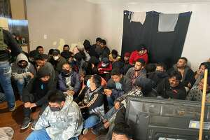 Laredo police and the U.S. Border Patrol rescued more than 100 immigrants from a mobile home in the Cheyenne Subdivision on Thursday.