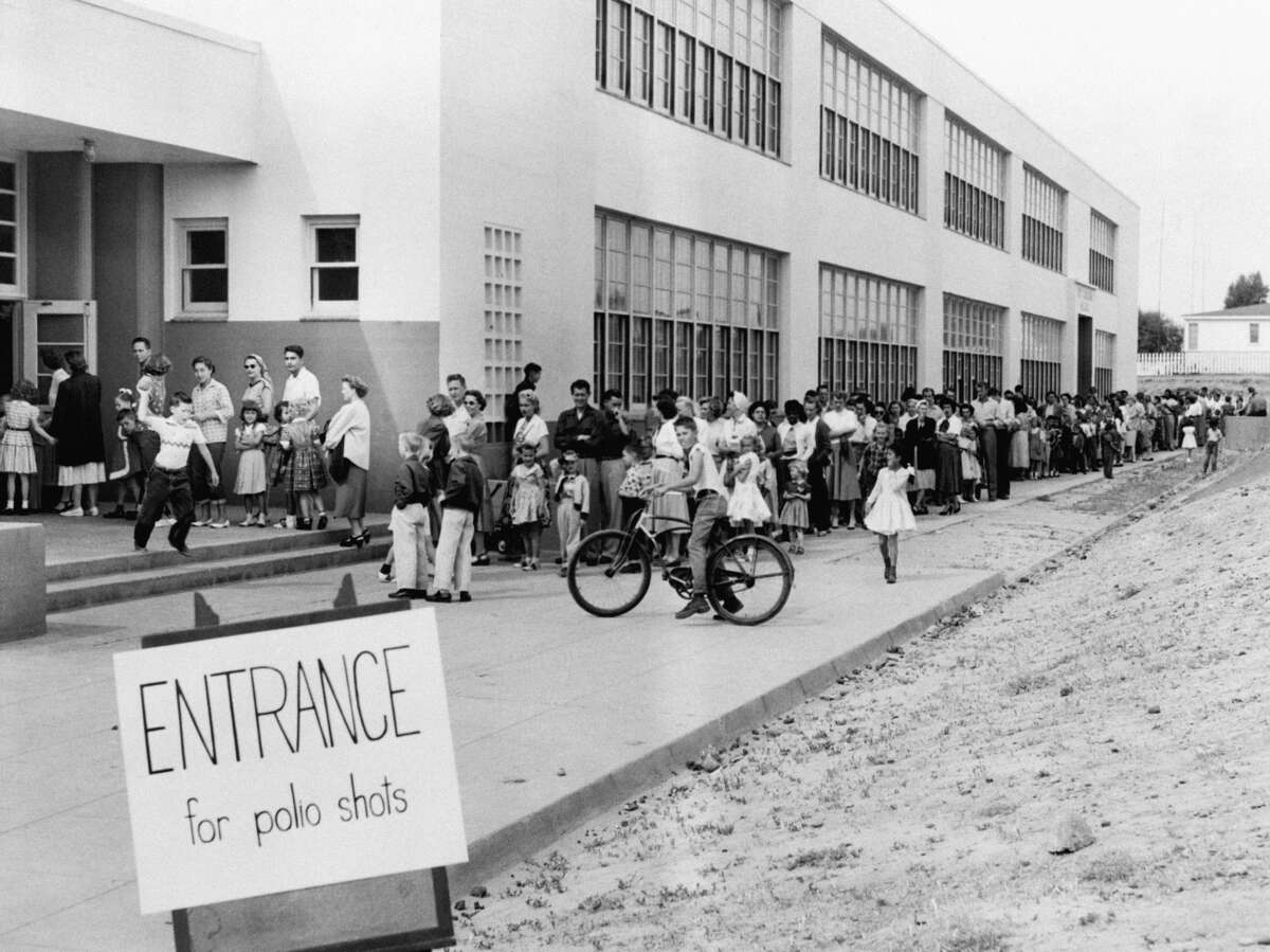 First and second graders at Kit Carson School in San Diego line up for Salk Polio vaccine shots on April 16, 1955.