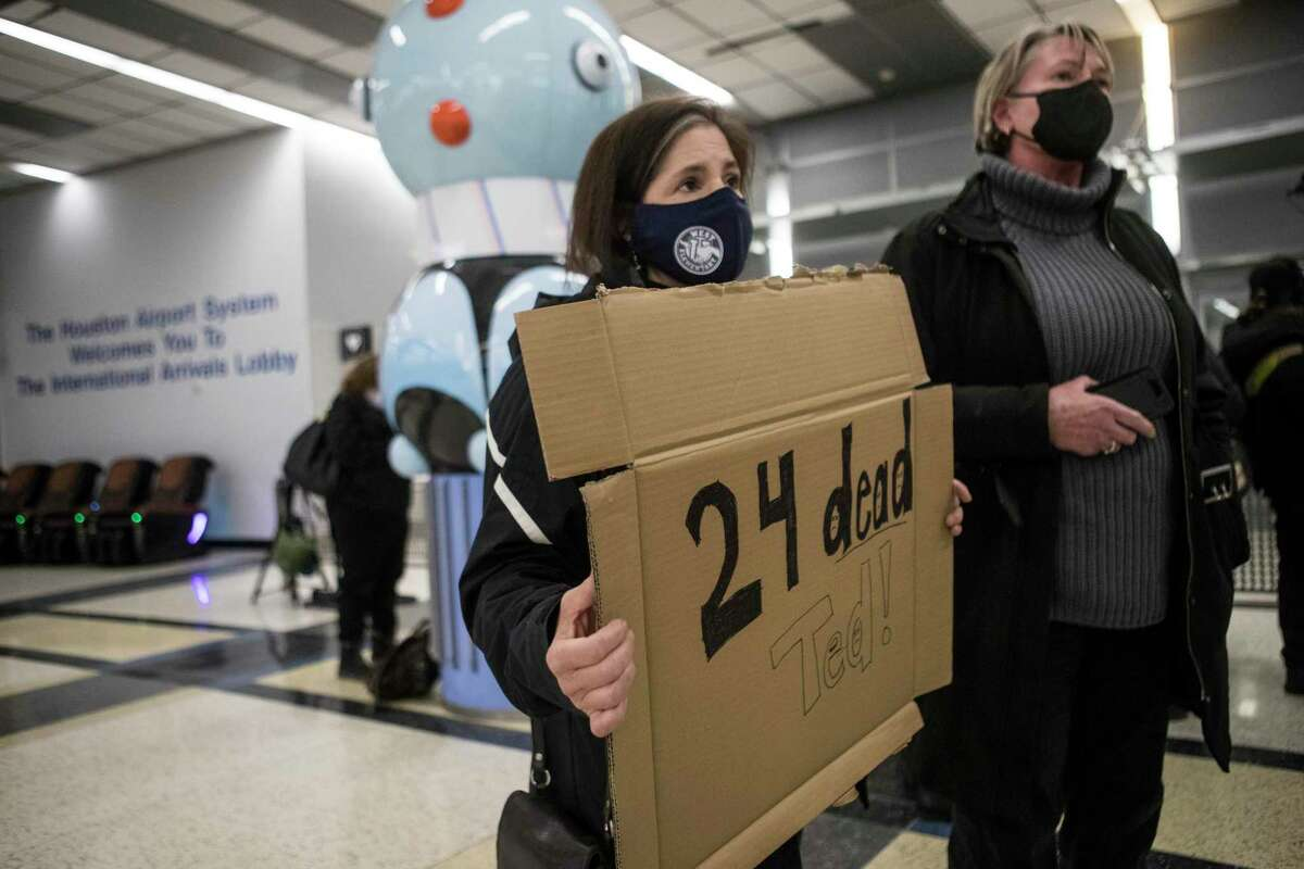 Mary K. Hoffman, left, and Cindy Durham came to Sen. Ted Cruz outside the international arrivals area in Terminal E at George Bush Intercontinental Airport Thursday, Feb. 18, 2021 in Houston.