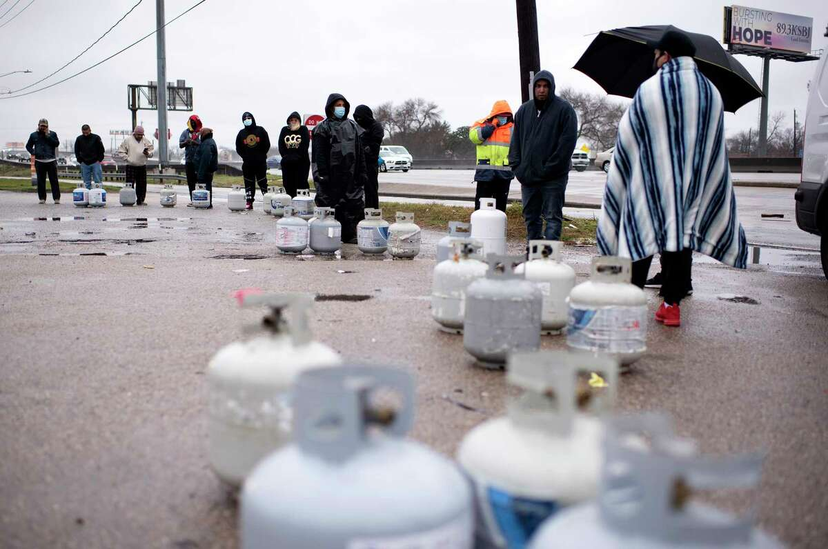 People wait with propane tanks for fresh supplies in Houston on Feb. 17.