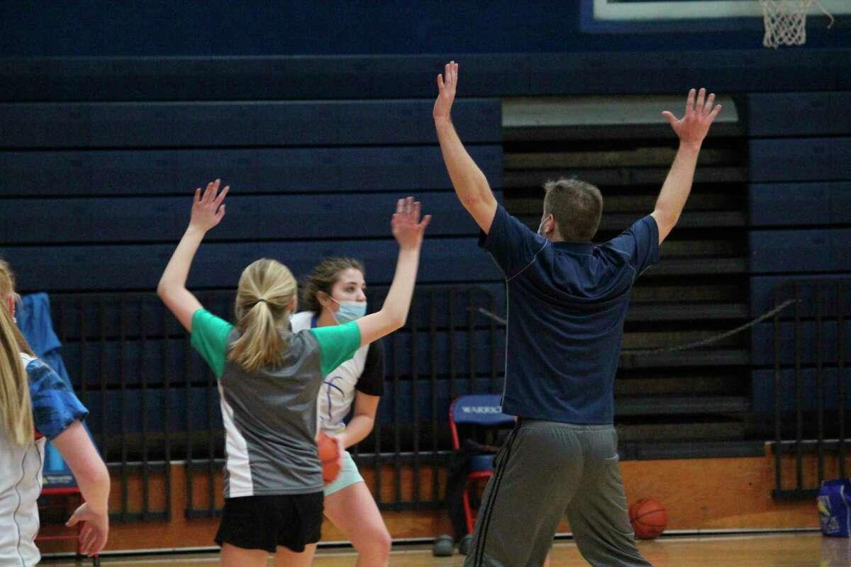 Chippewa Hills girls and their coaches go through a practice on Thursday. (Pioneer photo/John Raffel)