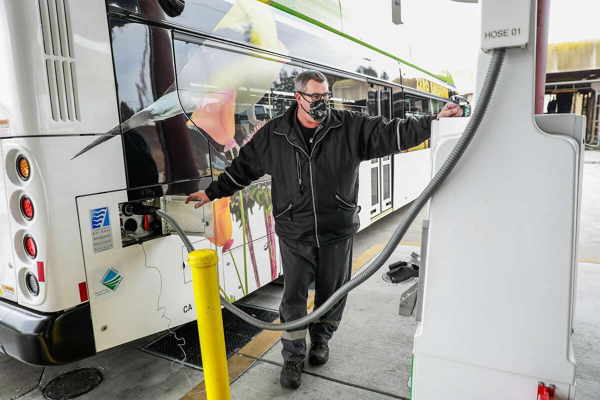 A worker fills an AC Transit bus with hydrogen fuel in Emeryville. Hydrogen gas can be stored and converted into electricity.