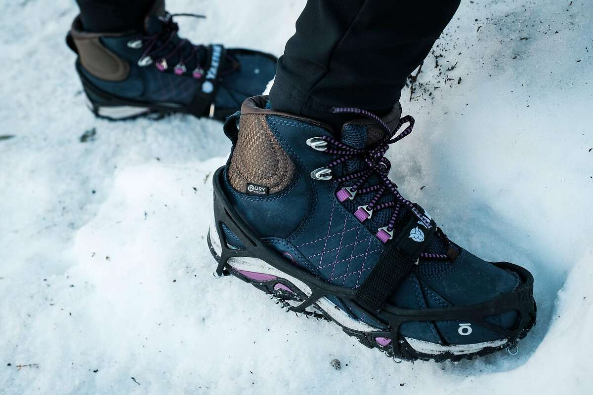 Jasmine Olvera of Reno wears traction devices on the John Muir Trail in Yosemite National Park.