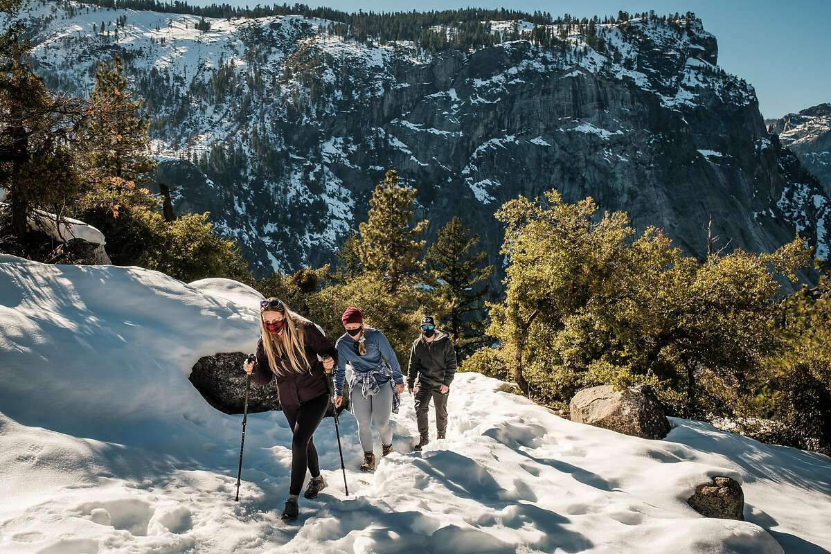 Pilar Svendsen (left), Shelbi Graifman and Alex Hughes hike the John Muir Trail in Yosemite National Park.