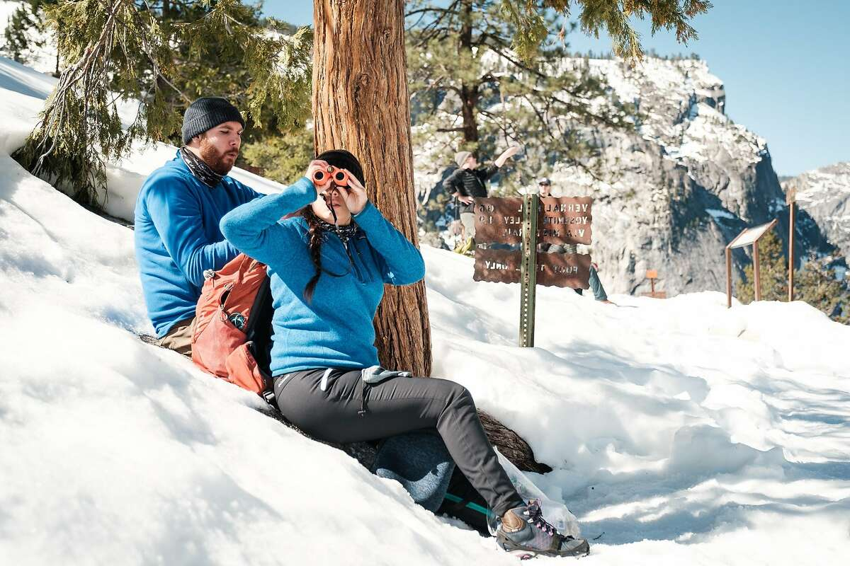 Jasmine Olvera of Reno uses binoculars to look at the course ahead on the John Muir Trail in Yosemite National Park.