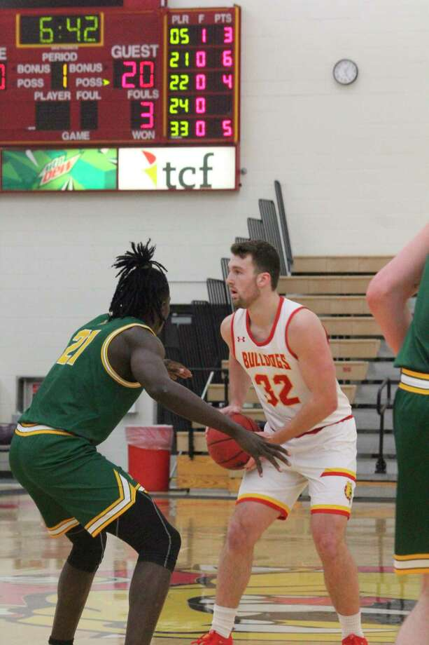 Ferris' Mason Pline is set to make a move in action earlier this season. The Bulldogs are home Friday and Saturday against Purdue Northwest. (Pioneer file photo)