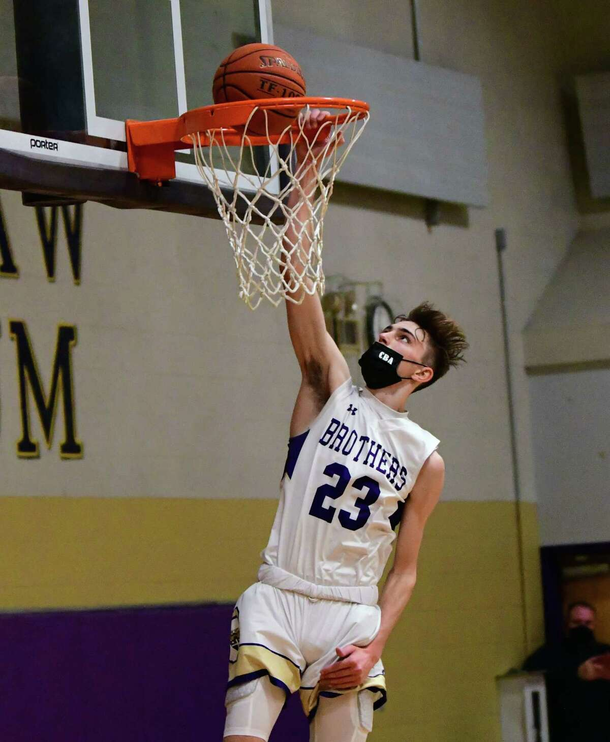 CBA's Hagen Foley dunks the ball during a basketball game against Guilderland on Thursday, Feb. 18, 2021 in Colonie, N.Y. (Lori Van Buren/Times Union)
