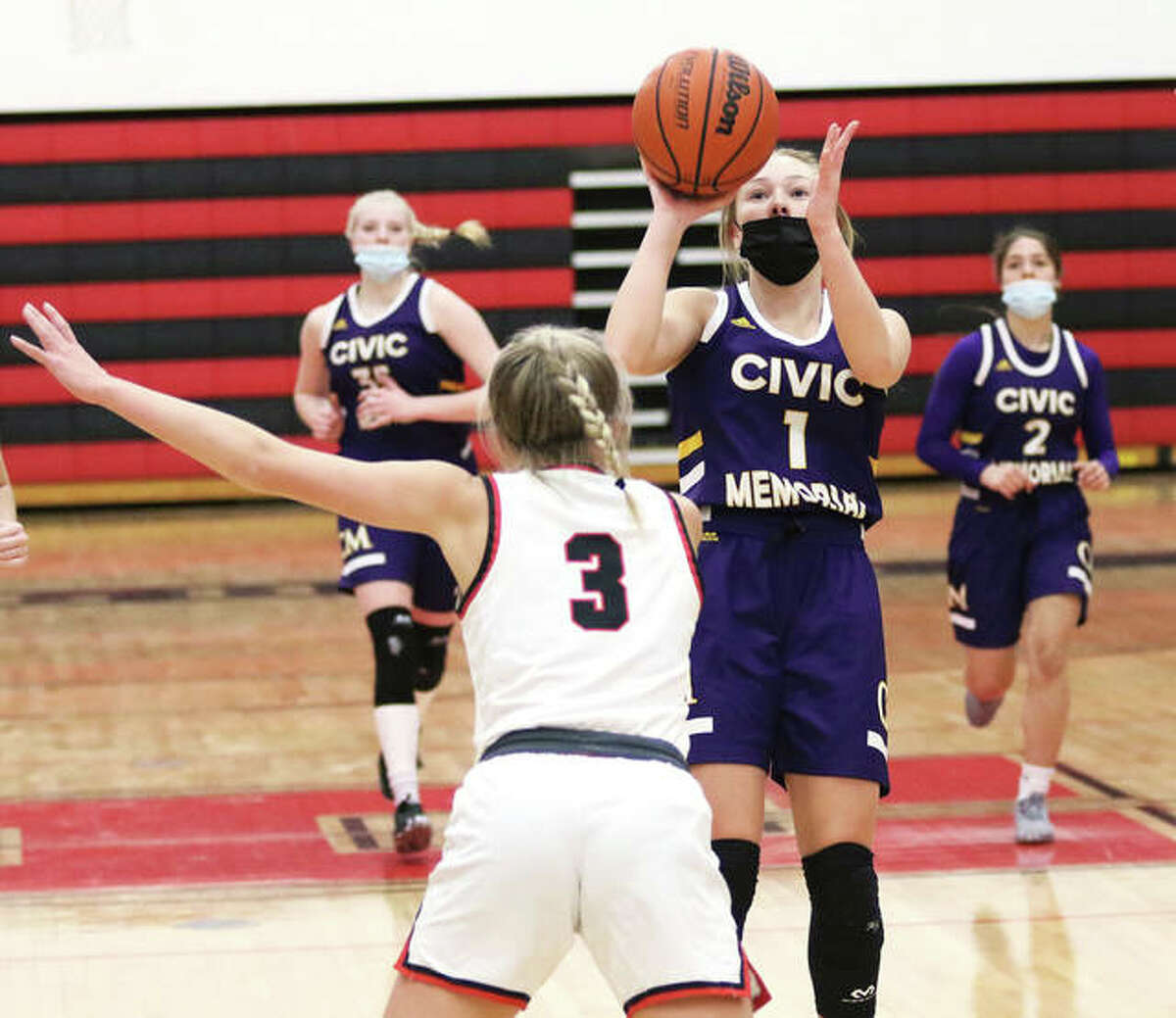 CM's Tori Standefer (1) pulls up to shoot over Highland's Liv Wilke during the first half of a Mississippi Valley Conference girls basketball game Thursday night in Highland.