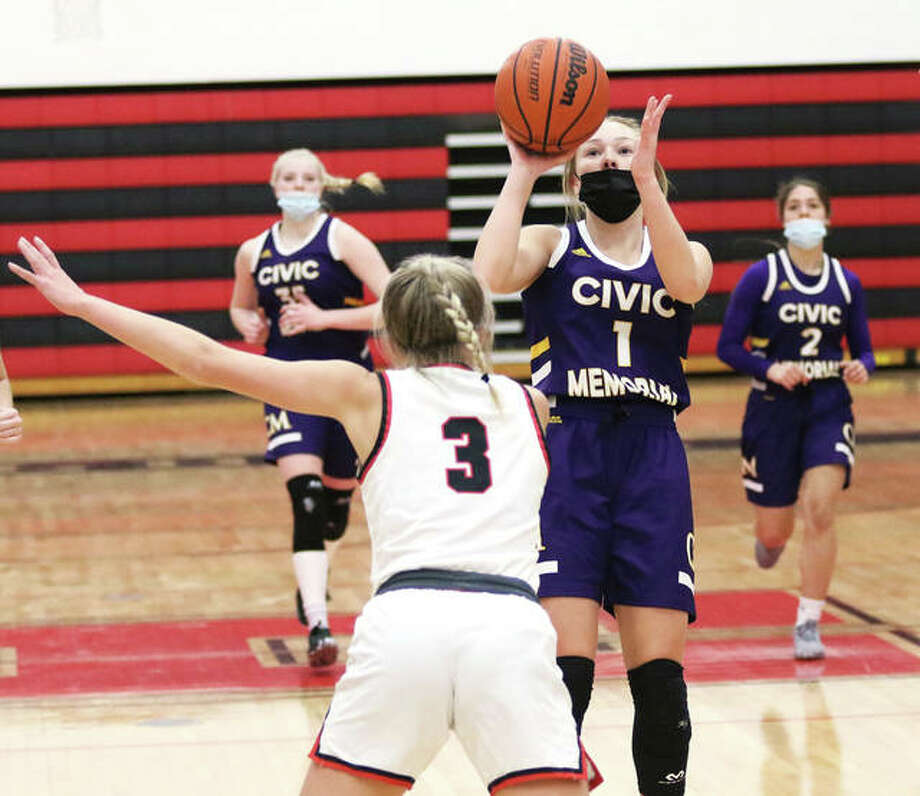 CM's Tori Standefer (1) pulls up to shoot over Highland's Liv Wilke during the first half of a Mississippi Valley Conference girls basketball game Thursday night in Highland. Photo: Greg Shashack / The Telegraph