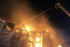 Firefighters work to control a fire as it engulfs a building Thursday night at the Cortland View at TPC apartments, 4092 TPC Parkway. There were no injuries, according to the Bexar-Bulverde Volunteer Fire Department.