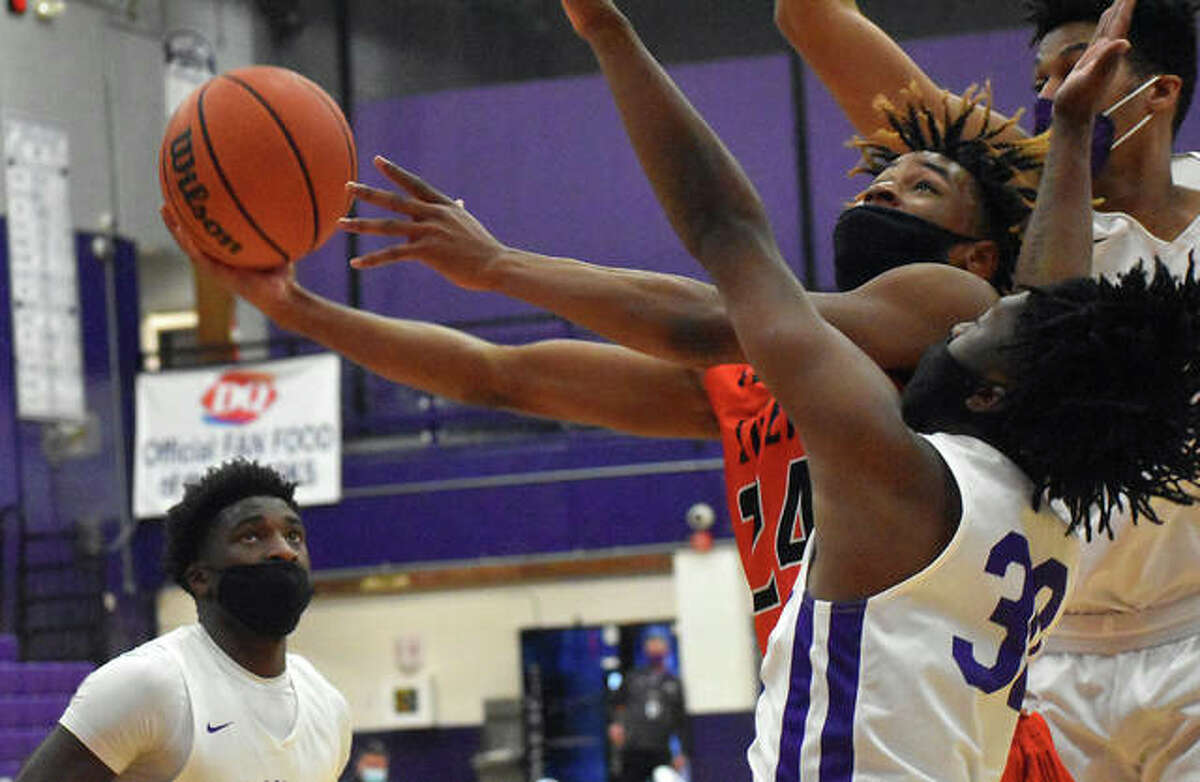 Edwardsville's Jalil Roundtree hits a contested shot in traffic to start a traditional three-point play early in the third quarter of Thursday's game against Collinsville inside Vergil Fletcher Gymnasium.