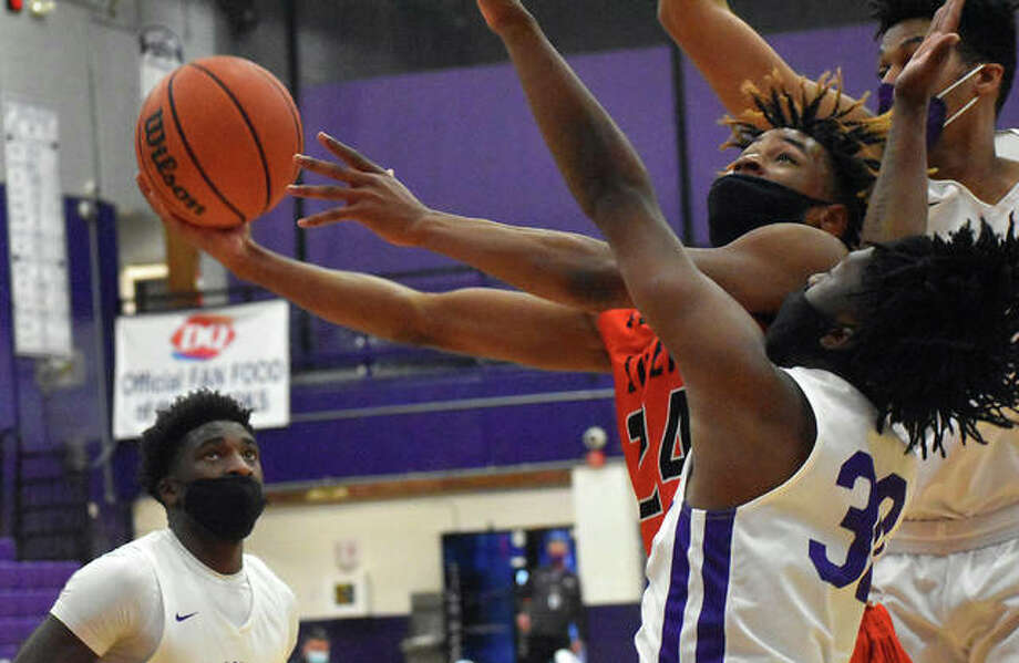 Edwardsville's Jalil Roundtree hits a contested shot in traffic to start a traditional three-point play early in the third quarter of Thursday's game against Collinsville inside Vergil Fletcher Gymnasium. Photo: Matt Kamp|The Intelligencer