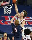 SPOKANE, WASHINGTON - FEBRUARY 18: Corey Kispert #24 of the Gonzaga Bulldogs shoots against Jabe Mullins #5 of the Saint Mary's Gaels in the second half at McCarthey Athletic Center on February 18, 2021 in Spokane, Washington. Gonzaga defeats Saint Mary's 87-65.  (Photo by William Mancebo/Getty Images)