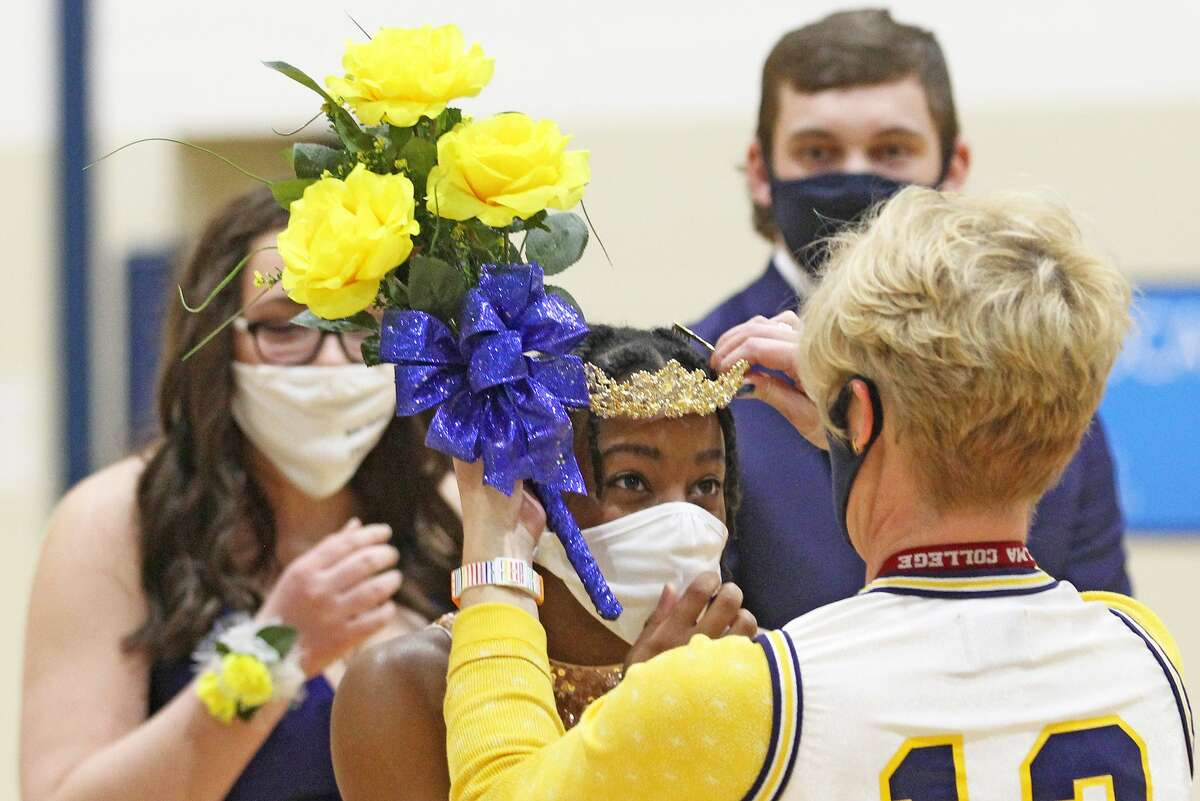 Nick MacAlpine and Alexis Booms were named king and queen of the Bad Axe High School Snow Carnival Court during halftime of the Hatchets boys basketball game on Thursday night.