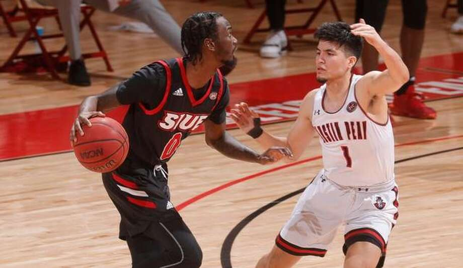 SIUE's Sidney Wilson shields the ball away from an Austin Peay defender while running the offense Thursday. Photo: SIUE Athletics