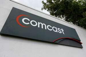 FILE - APRIL 23: According to reports, Comcast is ending its $45 billion dollar bid to takeover Time Warner Cable, April 23, 2015. POMPANO BEACH, FL - FEBRUARY 13: A Comcast sign is seen at one of their centers on February 13, 2014 in Pompano Beach, Florida. Today, Comcast announced a $45-billion offer for Time Warner Cable. (Photo by Joe Raedle/Getty Images)