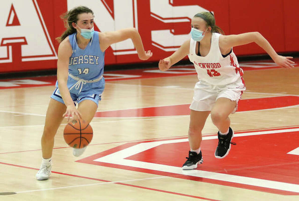 Jersey junior Chloe White (left) pushes the ball upcourt against a Chatham Glenwood defender during a Feb. 5 game in Chatham. On Thursday night in Jerseyville, White's double-double helped the Panthers to a win over Waterloo to improve their record to 5-0.