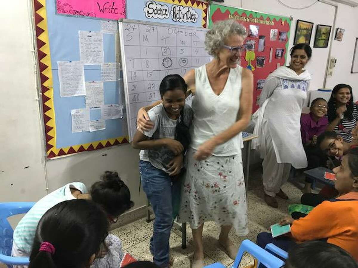 At top, Ellie von Wellsheim has traveled the world as part of the Mooncatcher Project, based in Schenectady. Here she teaches a class in India.