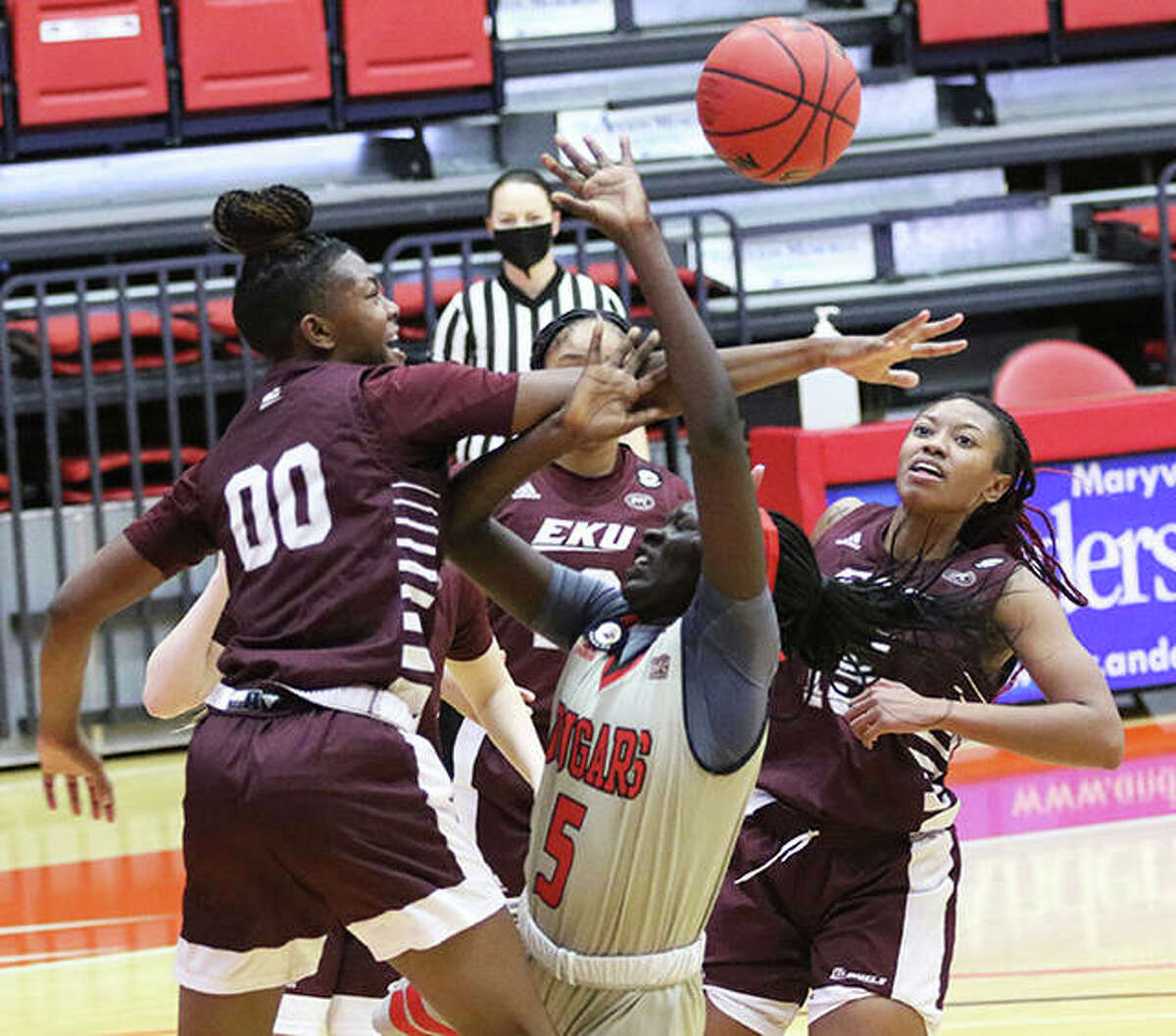 SIUE's Ajulu Thatha (5) draws a foul from an Eastern Kentucky shot blocker during a Jan. 14 game at First Community Arena in Edwardsville. The Cougars lost Thursday night at Austin Peay.