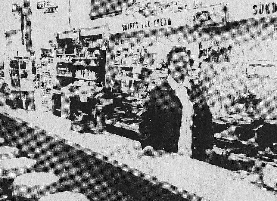 "From the Feb. 20, 1981 issue of the News Advocate, ""When Charlotte Tangerstrom Franckowiak started working at Merten's No. 2 in the late 1930s, a fountain Coke cost about $0.05 and sodas and sundaes were about $0.10. Those days are gone, as is the day of the drug store soda fountain on River Street as Saylor's Rexall Pharmacy (the former Merten's No. 2) prepares to close its door."" (Manistee County Historical Museum photo)"