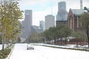 A car drives down Allen Parkway as a winter storm hits Houston on Monday, Feb. 15, 2021, in Houston.