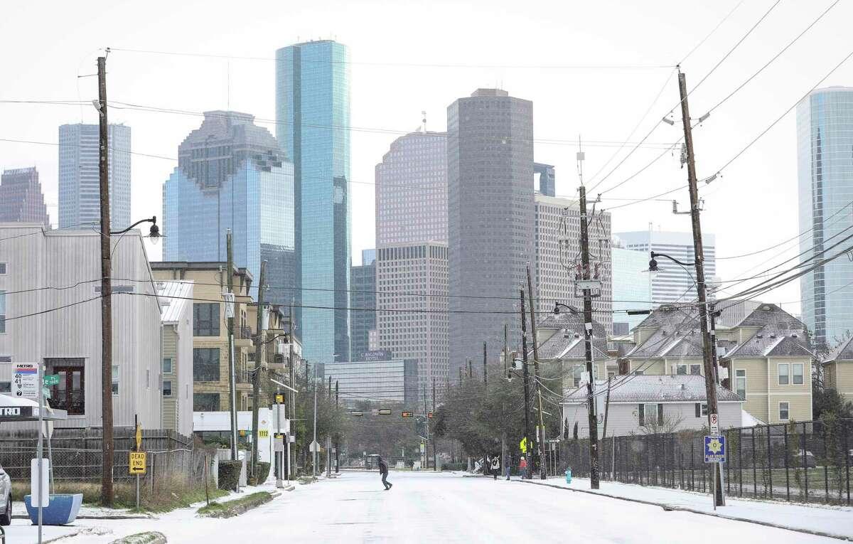 A man runs across West Dallas Street as a winter storm hits Houston on Monday, Feb. 15, 2021, in Houston.