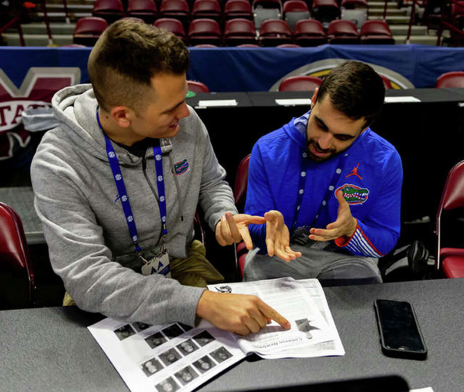 Sam Stolte, left, is working as an Assistant Director for the women's basketball and women's tennis teams at the University of Florida. His primary responsibility is working as a media liaison for the two programs. Photo: For The Intelligencer