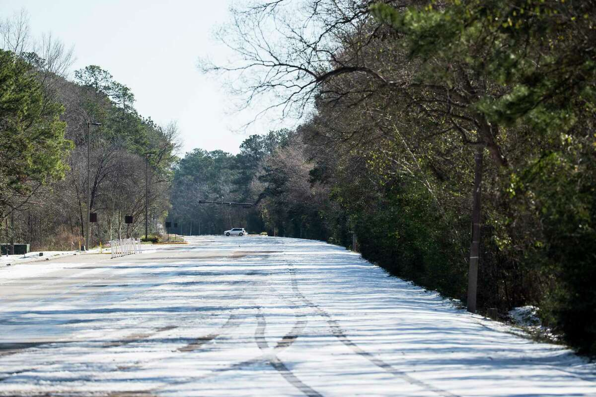 A single car drives across an empty Woodlands Parkway Tuesday, Feb. 16, 2021 in The Woodlands. Traffic continued to be light on the roadways as temperatures stayed below freezing Tuesday and roads remained icy.